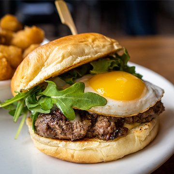 Brunch Burger Maple Bacon Onion Jam, Dijon Aioli, White Cheddar, Fried Egg on a Grilled Brioche Bun